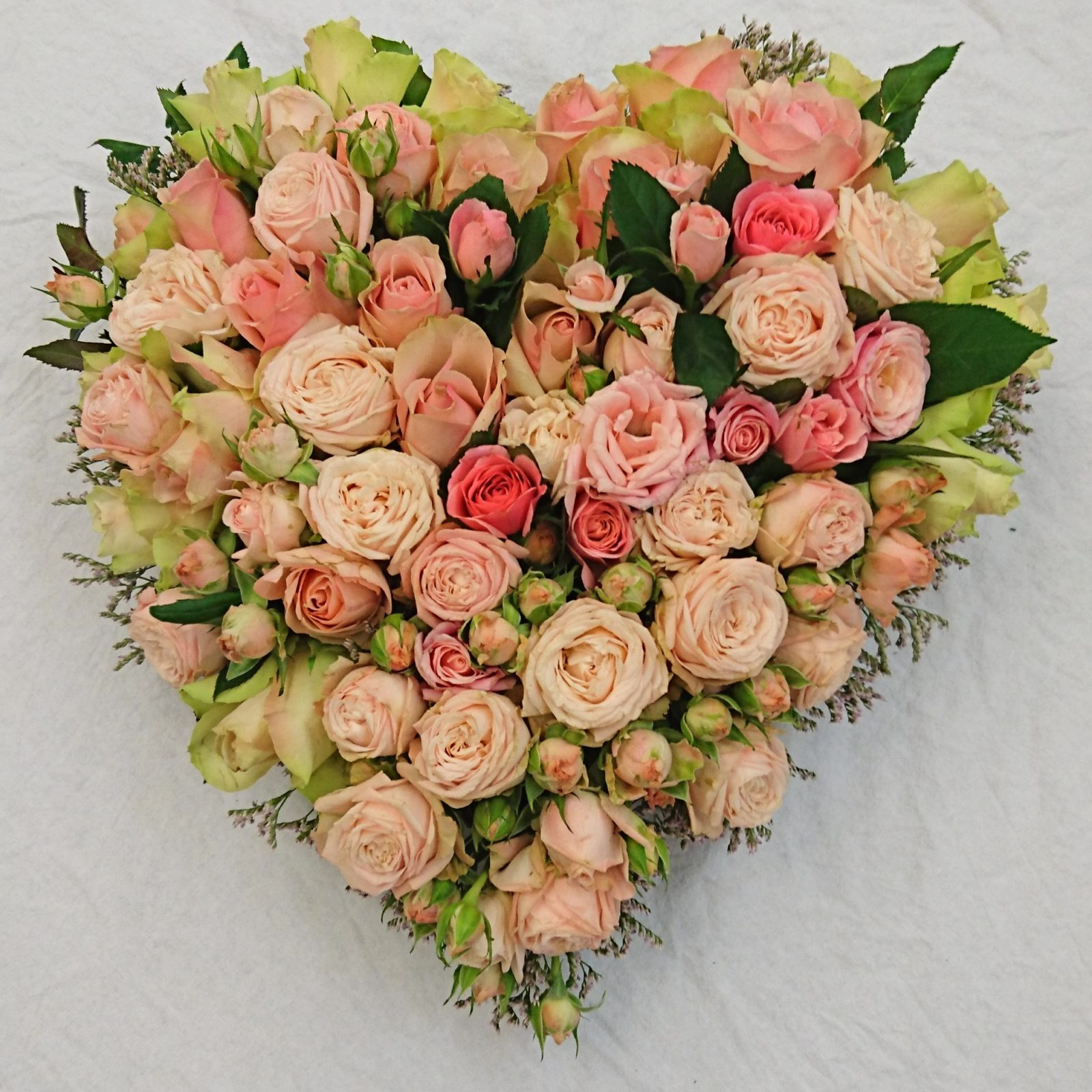 Blomsterhjerte-i-rosa-og-lysegront.jpg